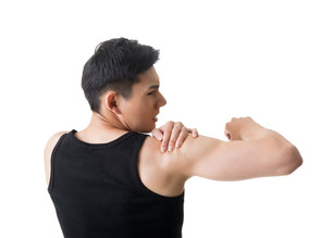 man in black singlet holding deltoid muscle having shoulder pain